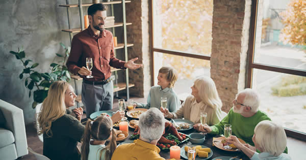 image of family gather for holiday meal